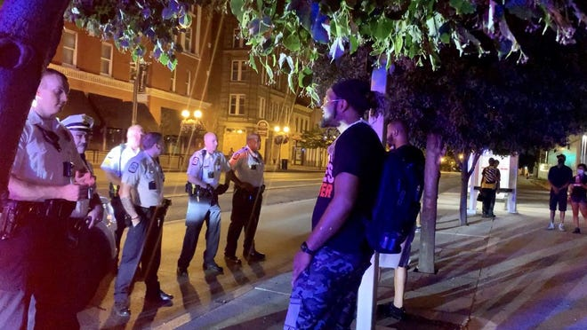 Joshua Williams, 34 of the Near East Side, argues with Columbus police after being pulled over for a second time at the corner of East Main and South High Streets on Sunday, June 28.