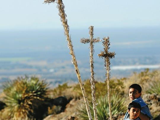 Young pilgrims pause near handmade quiotes (walking