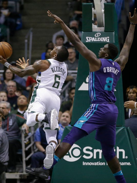 Milwaukee Bucks' Eric Bledsoe puts up a shot against Charlotte Hornets' Johnny O'Bryant III during the first half of an NBA basketball game Friday, Dec. 22, 2017, in Milwaukee. (AP Photo/Tom Lynn)p