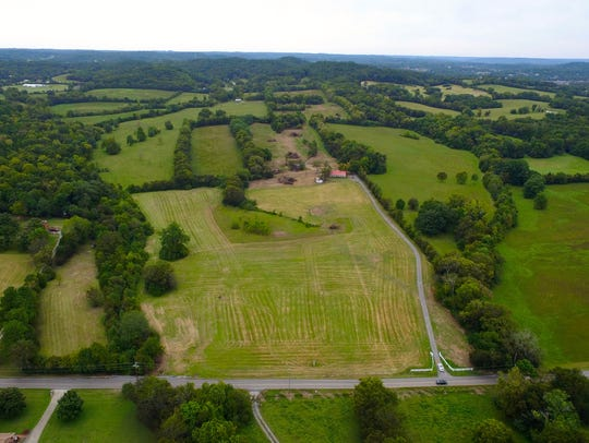 This aerial view shows the farmhouse on the site of