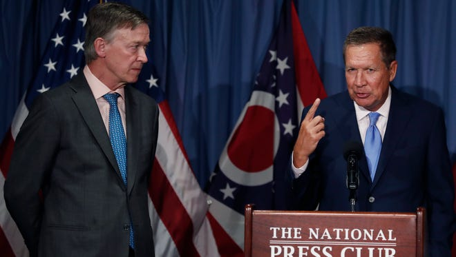 Ohio Gov. John Kasich, right, joined by Colorado Gov. John Hickenlooper, speaks during a news conference at the National Press Club in Washington on June 27, 2017, about Republican legislation overhauling Obamacare.
