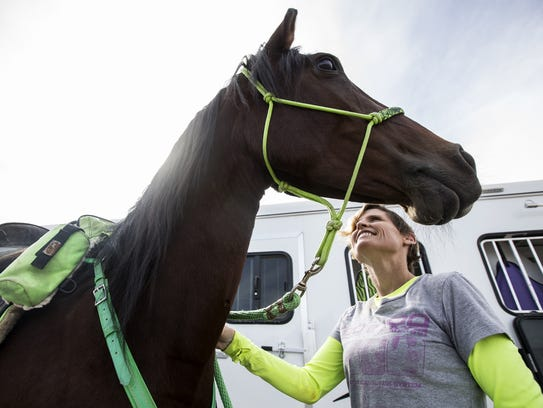 Andrea Maitland looks at her horse, Lilly, at Estrella Regional Park on Nov. 3, 2017, in Goodyear.