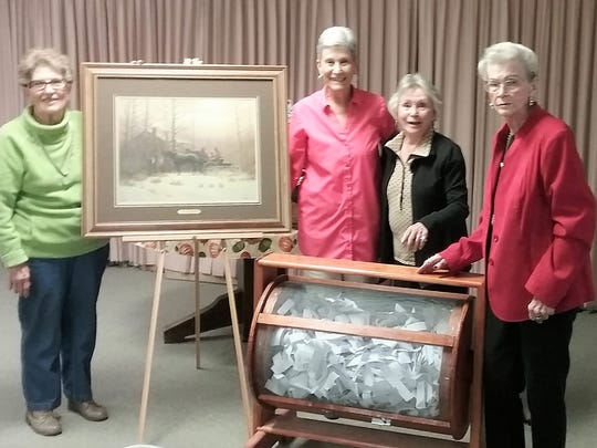 Overseeing the draw of the winning ticket are Wanda Sexe, Mary Van Orden, Club President, Geneva Franklin and Gladys Dendy.