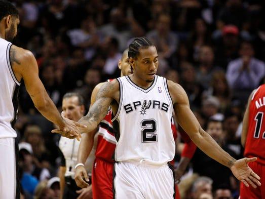 Game 5 in San Antonio -- Spurs 104, Blazers 82: San Antonio forward Kawhi Leonard celebrates a second-half bucket.