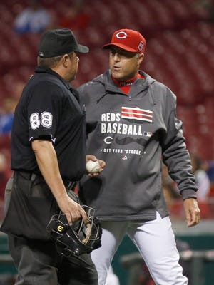 Cincinnati Reds manager Bryan Price has words with home plate umpire Doug Eddings (left) in the first inning against the Chicago Cubs at Great American Ball Park.