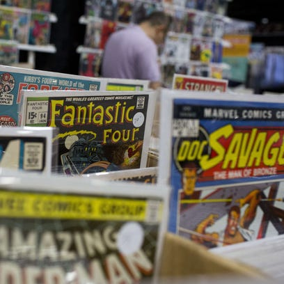 Comic books are displayed at the DC Awesomecon comic