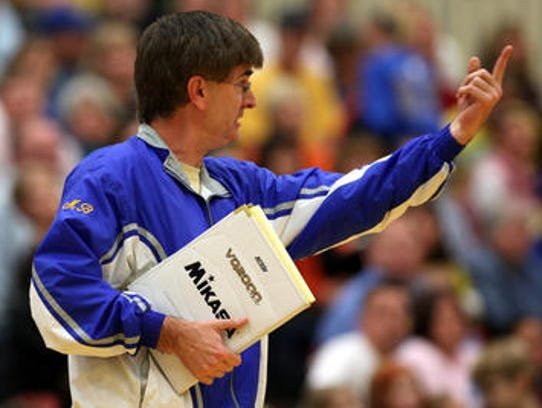 Steve Shondell coaches Burris during a match against