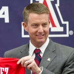 Arizona AD Greg Byrne offers absentee slip to watch College World Series