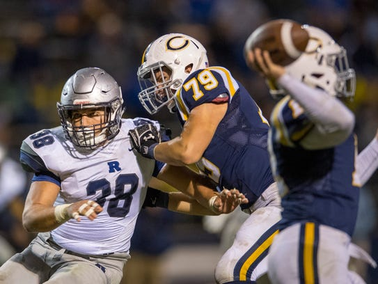 Reitz's Joey Diekmann (38) tries to evade Castle's Chase Tatern (79) earlier this season. Back at his customary linebacker position, Diekmann will lead the Panthers in their annual West Side rivalry game Friday against Mater Dei.