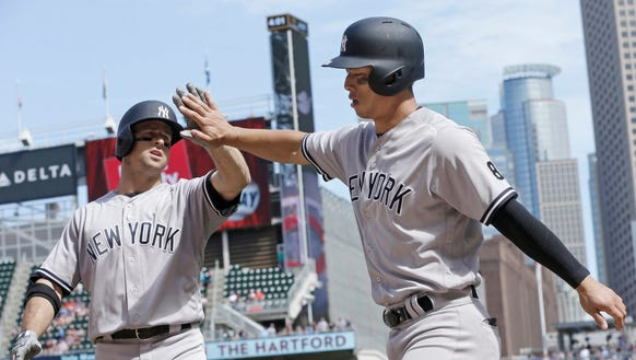 New York Yankees' Brett Gardner, left, congratulates