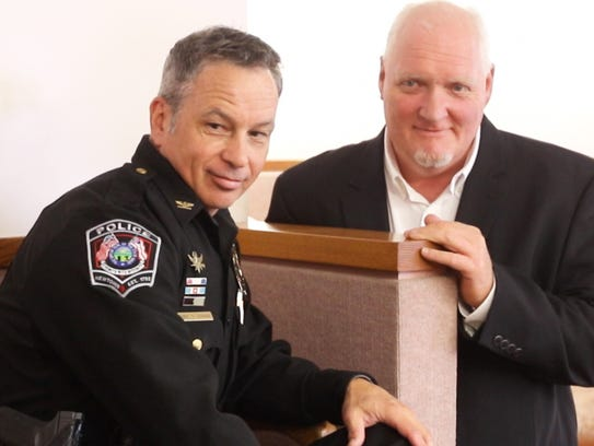 Newtown Police Chief Tom Synan and Harold look over