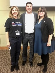 Town Hall Lecture – Indivisible Evansville hosted a Town Hall Lecture on Voting Rights at Ivy Tech Community College recently, discussing partisan gerrymandering, and how to end it. Speaker Ryan Hatfield is flanked by Edith Hardcastle and Katie Blair.
