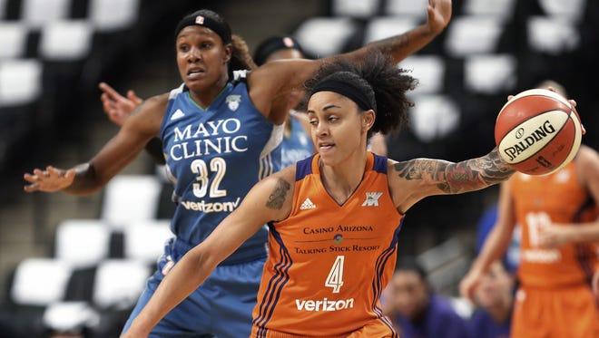 Phoenix Mercury's Candice Dupree, right, drives around Minnesota Lynx's Rebekkah Brunson in the first quarter of a WNBA playoff semi-finals basketball game Wednesday, Sept. 28, 2016, in St. Paul, Minn.