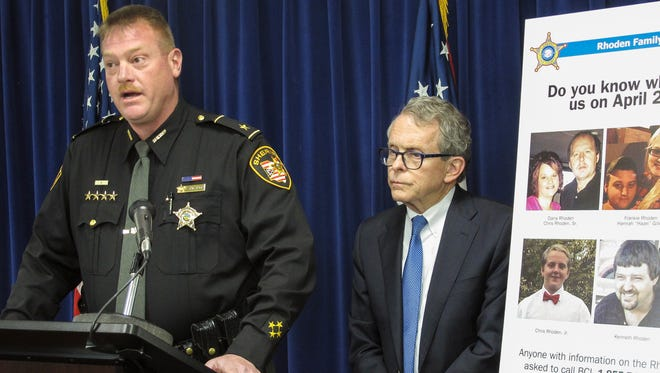 Pike County Sheriff Charles Reader, left, discusses the ongoing investigation into the unsolved killings of eight family members in southern Ohio on April 22, 2016, at a news conference attended by Attorney General Mike DeWine, whose office is leading the investigation, on Thursday, April 13, 2017, in Columbus, Ohio. Reader and DeWine both said they believe individuals may be holding back information out of fear of self-incrimination over their own, unrelated drug crimes. (AP Photo/Andrew Welsh-Huggins)