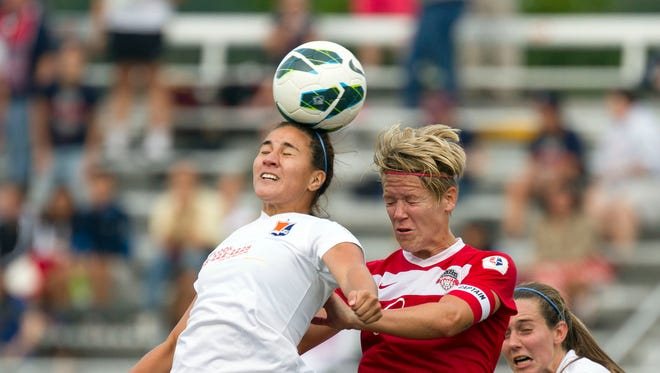 In a file photo from 2013, Washington Spirit midfielder Lori Lindsey (right) plays in a NWSL game. She is involved with Athlete Ally, which aims to provide an inclusive sports community.