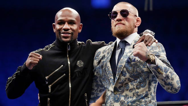 Showtime is being sued over the quality of the Floyd Mayweather Jr., left, and Conor McGregor fight coverage.