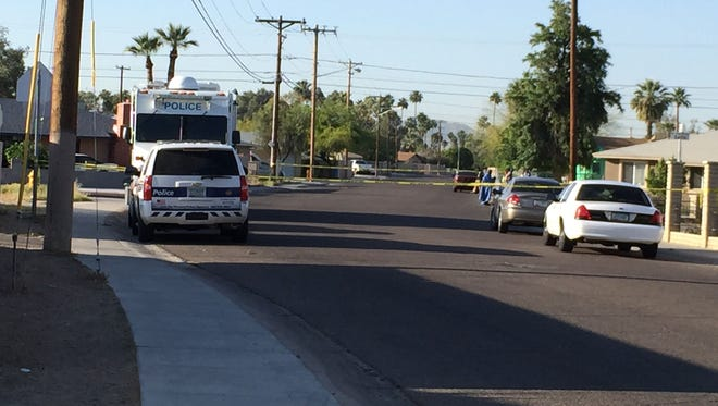 Phoenix police were looking for a shooter after a man was killed near 32nd and Campbell avenue on April 24, 2015.
