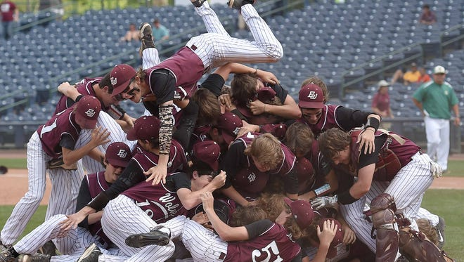 The East Webster celebration begins with the traditional dog pile near the pitchers mound on Saturday, May 23, the final day of the 2015 MHSAA Baseball State Championships at Trustmark Park in Pearl, Miss.