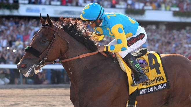 This photo provided by Equi-Photo, shows American Pharoah #4 with Victor Espinoza riding, winning the $1,750,000 Grade 1 William Hill Haskell Invitational at Monmouth Park in Oceanport, New Jersey on Sunday, Aug. 2, 2015. (Bill Denver/EQUI-PHOTO via AP)