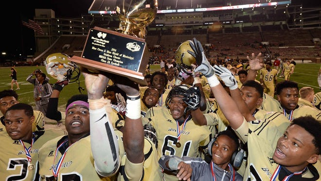 The Bassfield Yellowjackets celebrate their third consecutive MHSAA Class 2A football state championship on Friday, December 5, 2014, at Davis Wade Stadium on the Mississippi State University campus in Starkville. Bassfield beat Calhoun City 60-35.