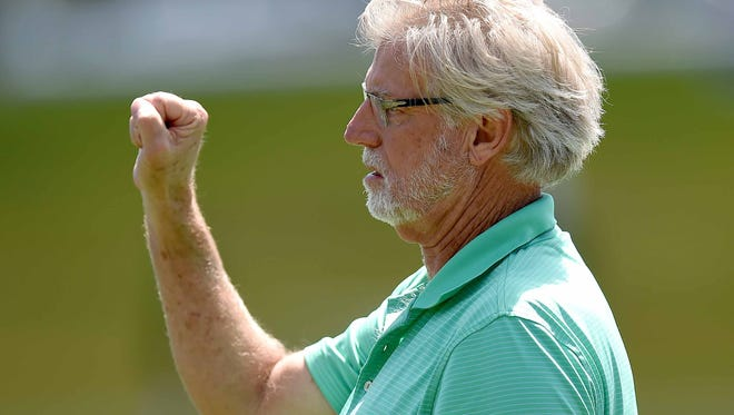 Belhaven head coach Hal Mumme signals an offensive play for the Blazers on Saturday, Sept. 12, 2015, at Newell Field in Jackson.