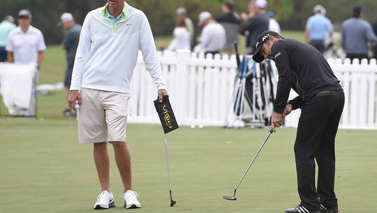 A golfer works on his putting on Monday for the Sanders