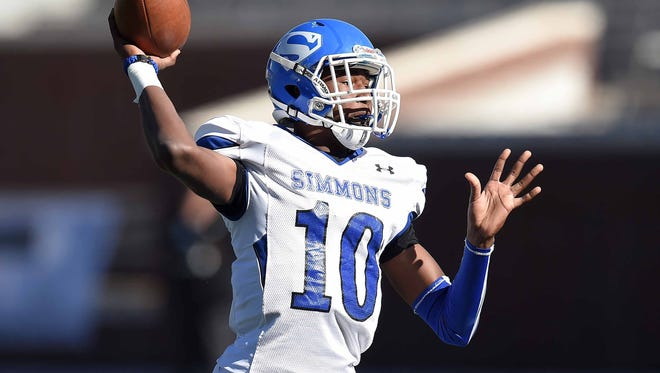 Simmons quarterback Chandler Robinson throws a sideline pass on Friday, December 4, 2015, at the MHSAA State Football Championships in Vaught-Hemmingway Stadum on the Ole Miss Campus in Oxford, Miss.