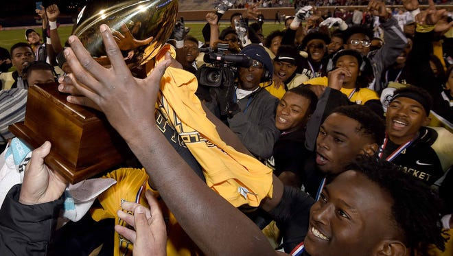 The Bassfield Yellowjackets celebrate for the fourth consecutive year with the Class 2A trophy on Friday, December 4, 2015, at the MHSAA State Football Championships in Vaught-Hemmingway Stadum on the Ole Miss Campus in Oxford, Miss.