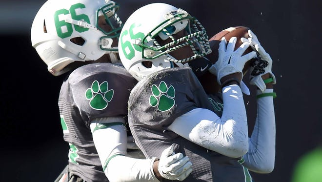 Collins' Martavious Washington (right) gets close back up from a teammate on a kickoff by Charleston on Saturday, December 5, 2015, in the MHSAA Class 3A State Football Championship in Vaught-Hemmingway Stadium on the Ole Miss  campus in Oxford, Miss.
