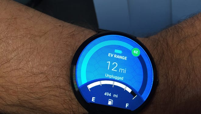 Dave Hatton, a Ford global product manager, is wearing a Motorola smartwatch with the MyFord mobile app that syncs with an electric vehicle to show its current status including the charge level.