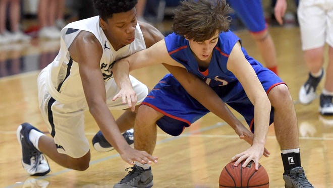 JA's Michael Barber (25) tries to steal the ball from Prep's Brandon McDowell (13) on Friday, January 8, 2016, at Jackson Academy in Jackson, Miss.