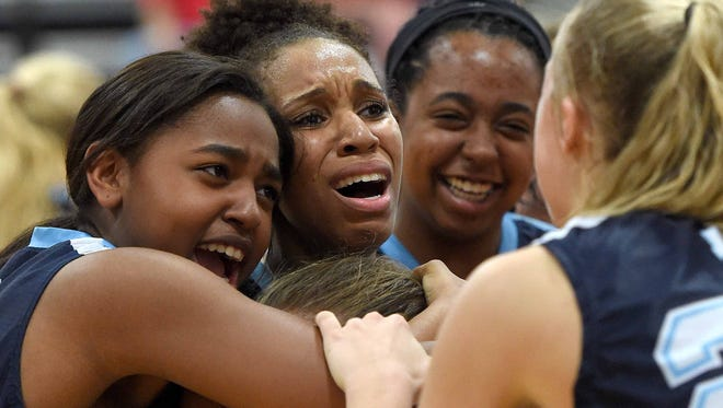 Jackson Academy's Deja Bradford (second from left) celebrates with her teammates after making the winning shot in overtime against Jackson Prep on Saturday in the MAIS AAAA championship. JA won 43-41.