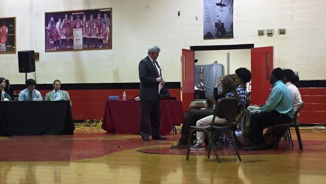 Avoyelles Parish District Attorney Charles Riddle (left) speaks on Wednesday to Bunkie High School students portraying jurors in a mock trial. The event was meant to warn students about the dangers of impaired and distracted driving.