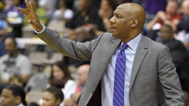 Columbus Falcon head coach Luther Riley directs the defense on Saturday, March 12, 2016, the final day of the MHSAA State Basketball Tournament at the Mississippi Coliseum in Jackson, Miss.