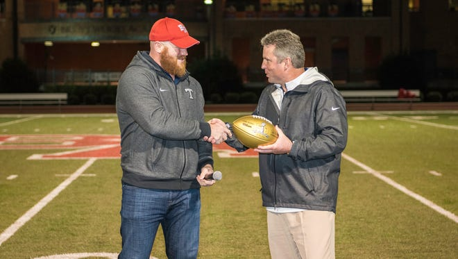 Scott Wells (left) was named the new Brentwood Academy wrestling coach Tuesday.