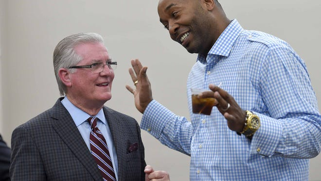 Former Mississippi State head basketball coach Richard Williams (left) shares a laugh with Tyrone Washington at a reception on Thursday, March 31, 2016, at the Mississippi Sports Hall of Fame and Museum in Jackson, Miss. The MSHOF museum hosted an event. Farm Bureau Salutes the Final Four Bulldogs, honoring Mississippis only Final Four men's basketball team from the 1996 NCAA tournament.