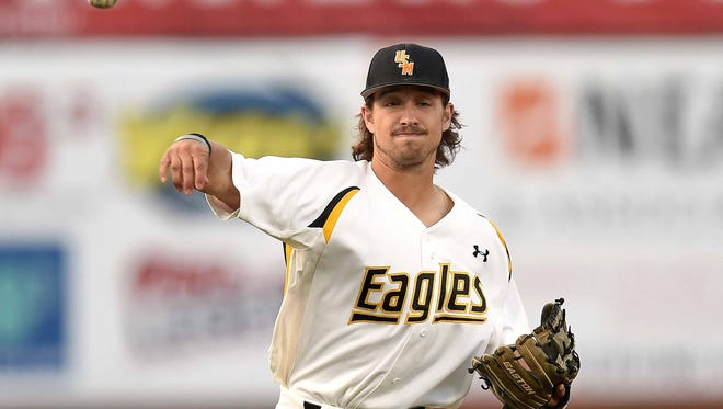 Southern Miss shortstop Nick Dawson throws to first against Ole Miss in the second of three games in the 2016 College Series on Tuesday, April 5, 2016, at Trustmark Park in Pearl, Miss.