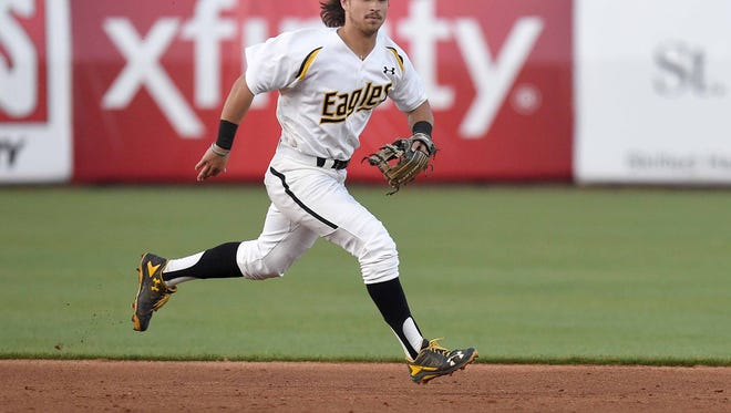 Southern Miss shortstop Nick Dawson tries to chase down a ground ball near second base in the second of three games in the 2016 College Series on Tuesday, April 5, 2016, at Trustmark Park in Pearl, Miss.