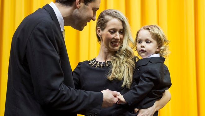 Vanderbilt's new men's basketball coach Bryce Drew greets his wife, Tara, and son, Bryson, after being introduced at Memorial Gymnasium, Wednesday, April 6, 2016, in Nashville, Tenn.