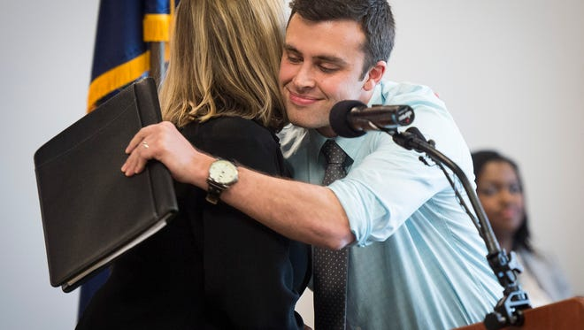 Nashville Mayor Megan Barry, left, hugs District 17 Councilman Colby Sledge during a news conference about affordable housing at the Midtown Hills Police Precinct on Monday in Nashville.