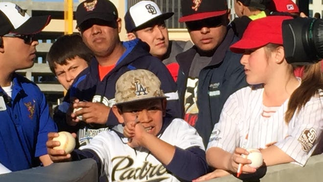 Chihuahua fans gather to get autographs recently at the ballpark in Downtown El Paso.
