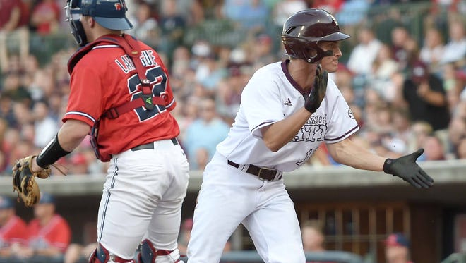 Mississippi State's Jake Mangum (right) celebrates scoring the first run of the game for the Bulldogs against Ole Miss on Tuesday, April 26, 2016, in the third and final game of the 2016 College Series at Trustmark Park in Pearl, Miss.