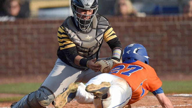 Hernando catcher Reese Lara prepares to tag out Madison Central's Elliot Ainsworth (27) on Thursday in Game 1 of the second round series.