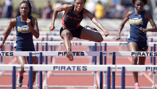 Clinton's Monica Mosley won the 100 meters on Friday at the Class 6A championship track meet held at Pearl as the Lady Arrows won their fourth state title in a row.