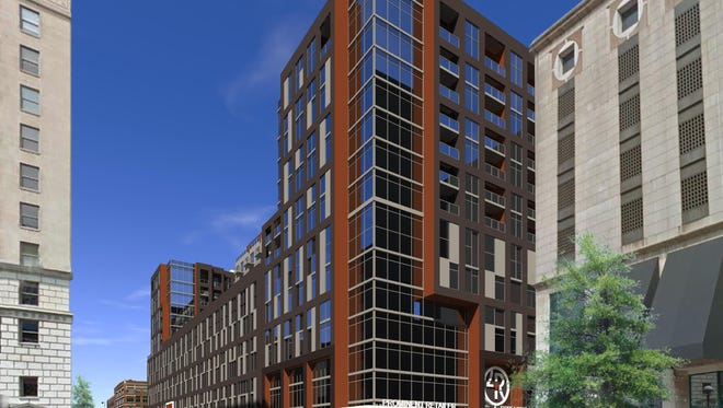 A previous rendering of the mixed-use development planned at the northwest corner of Fourth and Race streets. Flaherty & Collins and the Cincinnati Center City Development Corp. are working on a project to reshape a Downtown city block with 225 new apartments, 30,000 square feet retail space and a 700-space parking garage. The Fourth and Race project is expected to begin with the demolition of the existing Pogue's garage and an elevated walkway spanning Race Street.