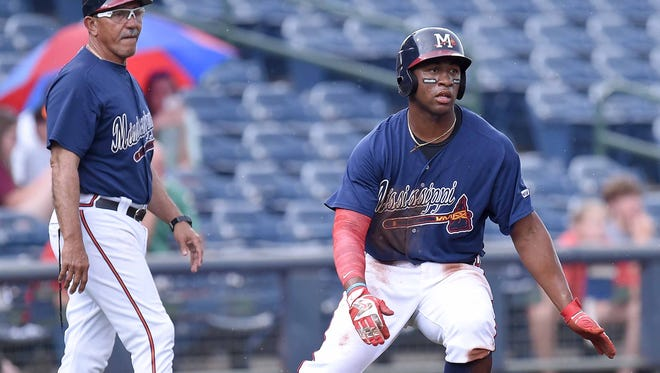 Mississippi Braves outfielder Mel Rojas Jr. (right) homered Friday night to help the Braves beat the Barons 7-1 in Birmingham.
