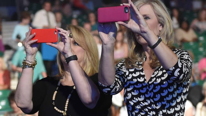 Fans and family members shoot photos and videos before the show on Wednesday, June 22, 2016, the first of three nights of preliminary competition in the Miss Mississippi Pageant at the Vicksburg Convention Center in Vicksburg, Miss.