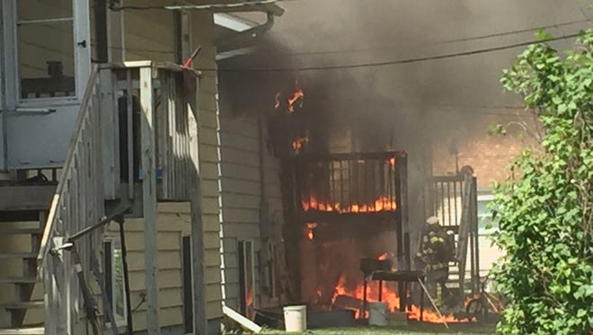 A deck can be seen burning about noon Sunday at a St. Cloud home.