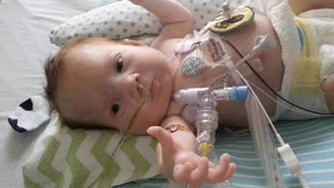 This 2013 photo provided by Kara McHenry of North Carolina shows her son, Corbin, who lived for four months after his birth in April 2013.