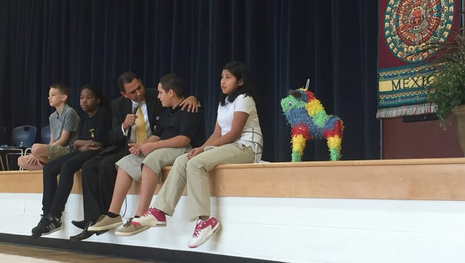 Metro Nashville Public Schools priority schools officer Moreno Carrasco talks with students during a Hispanic Heritage Month assembly at Goodlettsville Middle School on Sept. 29, 2016.